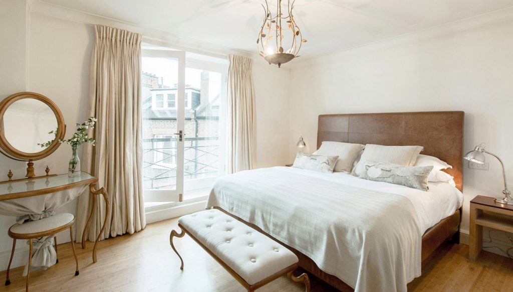 A grand bedroom at Europa House Apartments
