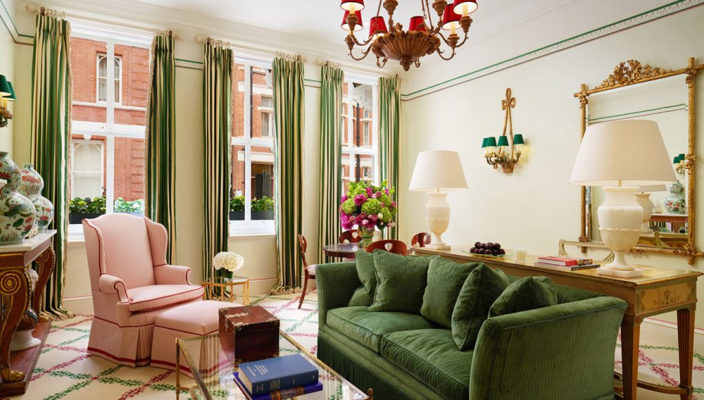 Plush green and pink decor in this luxury London serviced apartment
