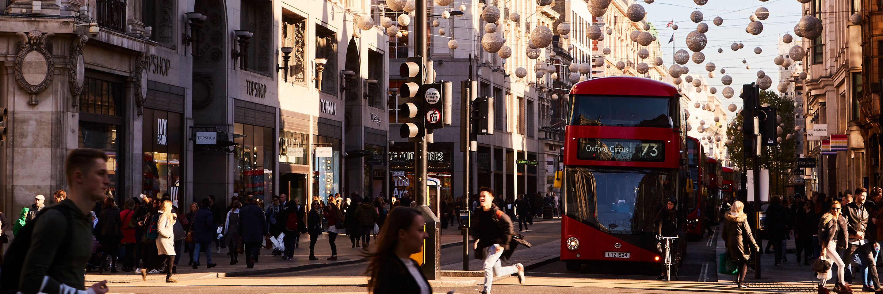 Busy Oxford Street with red double-decker, route 73